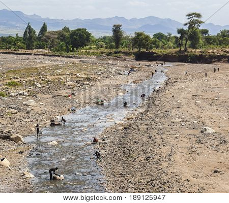 People From Konso Tribal Area Wash Clothes In A River. Omo Valley. Ethiopia