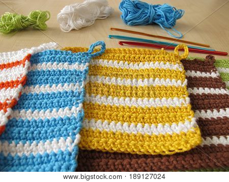 Handmade crochet potholders, wool and crotchet hook