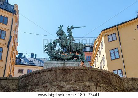STOCKHOLM, SWEDEN - MAY 19, 2017: Statue of Saint George and the dragon in medieval Old Town of Stockholm. The historic Old Town is a major tourist attraction.