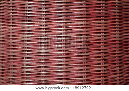 Front view of deep red colored rattan furniture surface, for background and pattern