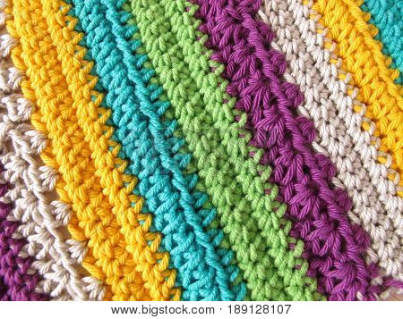 Crochet pattern background with crochet stitches from wool