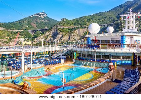 Salerno Italy - June 11 2016: Cruise ship anchored in the port of Salerno in Italy. Passengers disembark for a day in the European city.