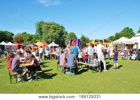 TENTERDEN, ENGLAND - MAY 21, 2017: People enjoying the Food and Drink Festival at Tenterden in Kent. The festival was held for the first time in 2017 and hopes to become an annual event.