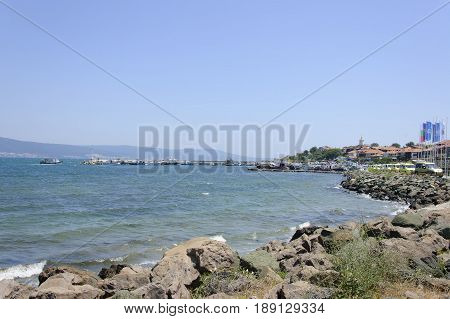 The view of Old Nessebar and Nessebar Bay at sunny summer midday