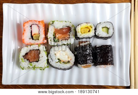 Japanese food sushi on a ceramic plate.
