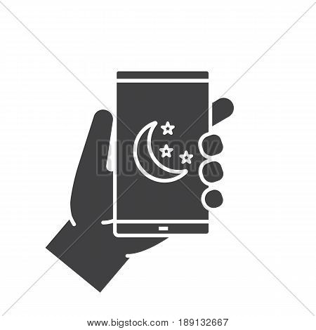 Hand holding smartphone glyph icon. Silhouette symbol. Smart phone night mode. Negative space. Vector isolated illustration
