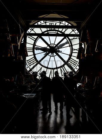 Paris, France, March 28 2017: inside orsay museum and there is a big clock two people stand beside the clock