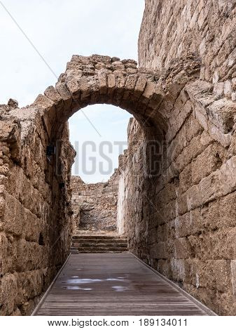 The ruins of a Roman archway on what may have been a street in ancient Caesarea Maritima in Israel.