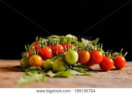 Stil life group of tomato on old wood and black background soft focus
