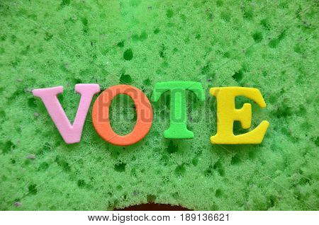word vote on a  abstract green background
