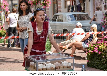 Russia, Moscow, Mary 23, 2017. Ice cream seller on Old Arbat