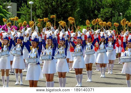 ALMATY KAZAKHSTAN - JUNE 1 2017: Solemn parade of children's and youth musical orchestras and ensembles on the Republic Square. More than 5000 schoolchildren took part in the parade.