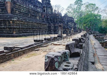 Baphuon Temple in Angkor Complex, Siem Reap, Cambodia. It is three-tiered temple mountain and dedicated to the Hindu God Shiva. Ancient Khmer architecture and famous Cambodian landmark, World Heritage
