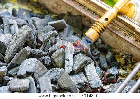 Some Charcoal is switched on in the garden