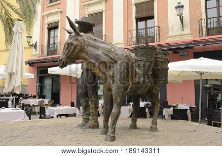 GRANADA, SPAIN - MAY 21, 2017: Sculpture of water carrier in Romanilla Plaza in the city of Granada Andalusia Spain.