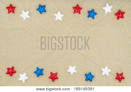 Patriotic USA background with stars decorations on the sandy beach