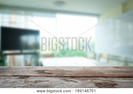 Selected focus empty old wooden table and meeting room or office work blur background image. for your photomontage or product display.