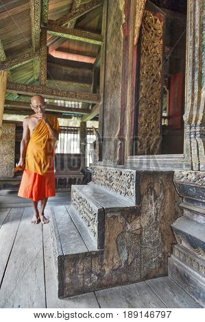 Yasothon Thailand - May 2017: Ancient carved wooden stairs up to the main storage room where Pali manuscripts are kept in Ho Trai or the library of Tripitaka located at Wat Mahathat Temple