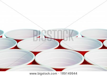 Many red party cups isolated on white. Close up of college alcohol containers with free empty blank copy space for text. Event marketing and promotion background template.