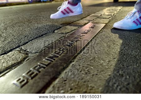 BERLIN GERMANY - APRIL 8: Crossing Berlin wall - memorable table Berliner mauer on April 8 2017 in Berlin