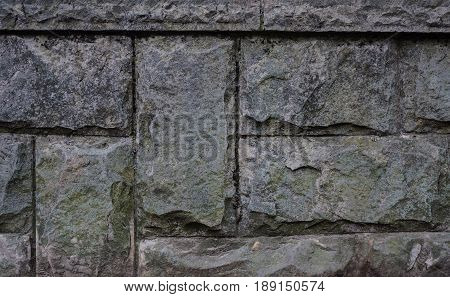 Close up of old gray stone block border texture