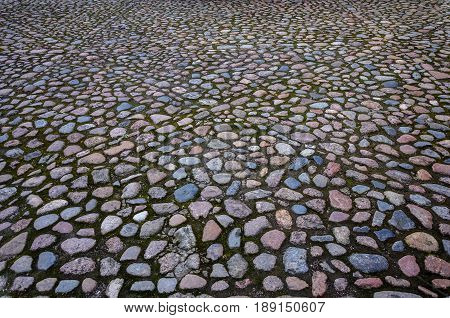 Texture of the round cobblestone pavement surface