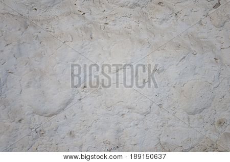 White rough plastered stone wall background with dust