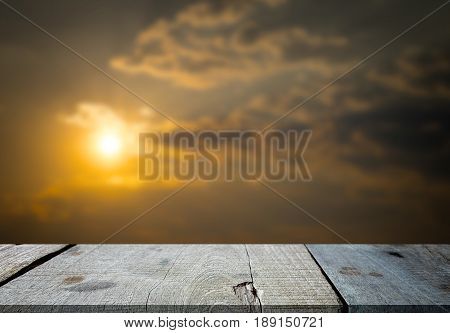 Selected focus empty gray wooden table and sunshine in the evening texture or summer background image. for your photomontage or product display.