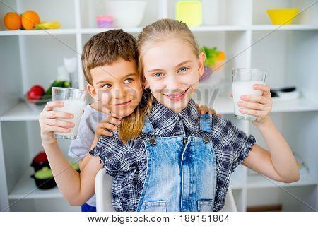 Happy children drink milk. food and drink concept, healthy food, indoor