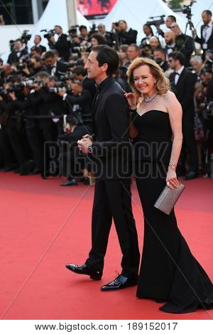 Caroline Scheufele and Adrien Brody attend the Closing Ceremony during the 70th annual Cannes Film Festival at Palais des Festivals on May 28, 2017 in Cannes, France.