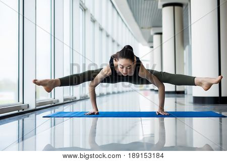 Pose Dedicated To The Sage Koundinya I. Beautiful Yoga Woman Practice In A Big Window Hall Backgroun