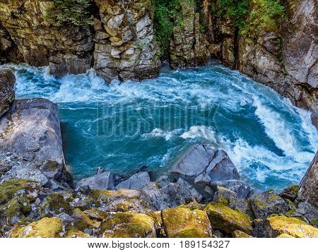 Mountain river with wild rapids, sunny day