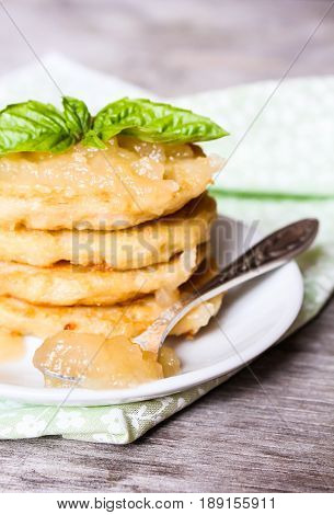 Potato pancakes with apple sauce on a plate, selective focus