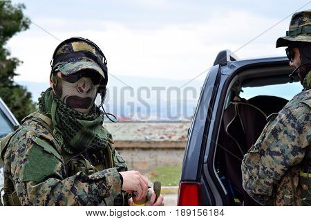 Soldier On Hand Smoke Grenade Headset Communication Disembark From Car