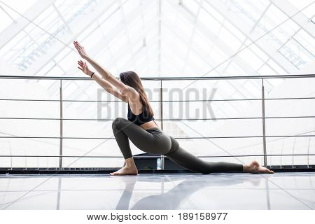Beautiful Yoga Woman Practice In A Training Hall Background. Yoga Concept.