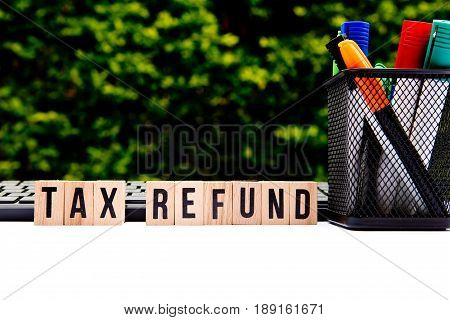 Tax Refund - wooden letters with pen holder