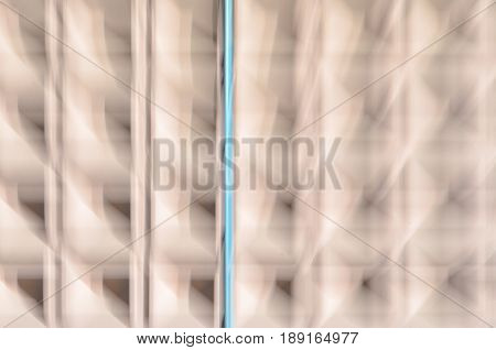 Abstract motion blur background of concrete wall with square cells geometrical pattern