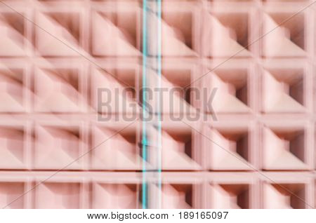 Abstract motion blur background of red concrete wall with square cells geometrical pattern