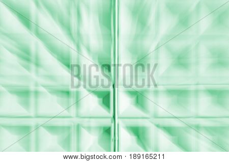Abstract motion blur background of greenconcrete wall with square cells geometrical pattern