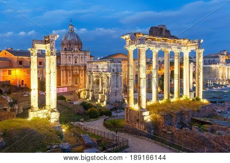 Ancient ruins of a Roman Forum or Foro Romano during evening blue hour in Rome, Italy. View from Capitoline Hill