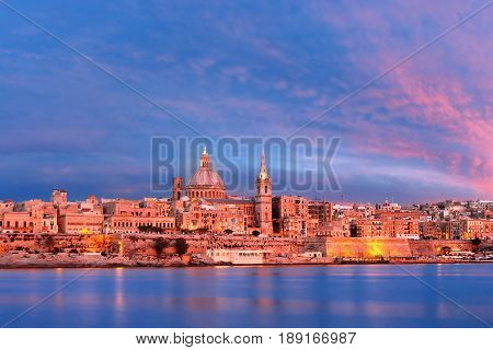 Valletta Skylineat at beautiful sunset from Sliema with churches of Our Lady of Mount Carmel and St. Paul's Anglican Pro-Cathedral, Valletta, Capital city of Malta