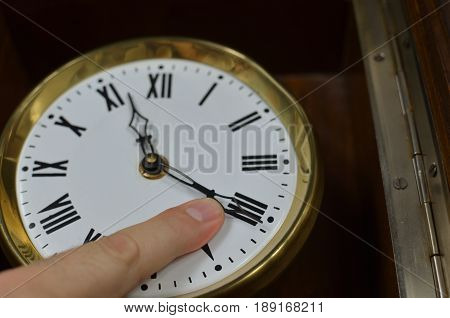 Finger On A Clock Hand