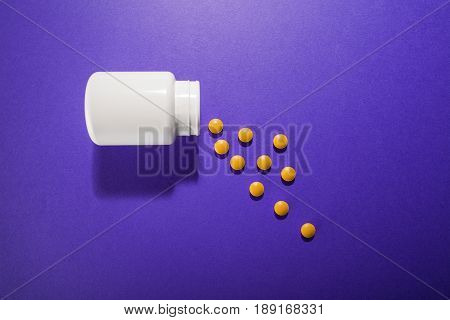 Medical Pills Vitamins On A Colored Background With A Vial