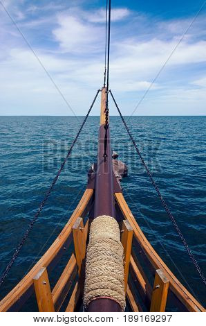 View to the sea from the bow of sailing ship. Sea voyage spirit of adventures.