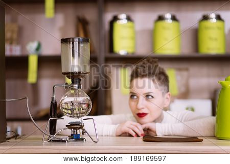 The Girl Is Making Tea In A Cafe