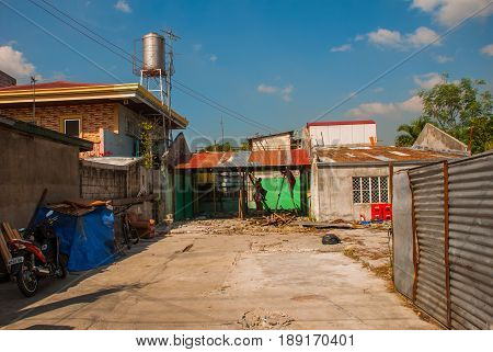 Local Street With Houses. Philippines Manila