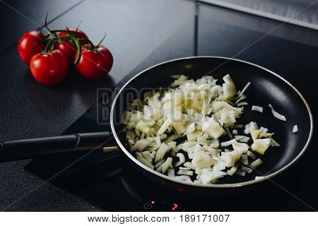Frying Chopped Onion On Olive Oil