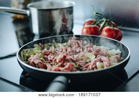 Frying Minced Pork With Vegetables On Olive Oil.