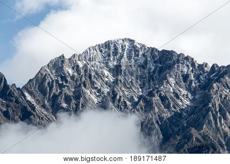 The Amazing textures of a mountain range shrouded in clouds in Banff National Park Alberta Canada.