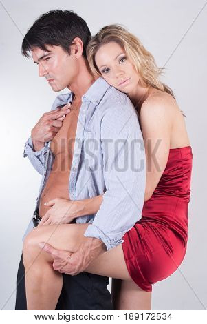 The lucrative couple is in a cute pose.